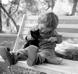 cute-child-shares-food-with-her-tiny-pet-kitten