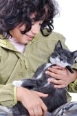 5731289-very-cute-child-with-a-cat-in-arms